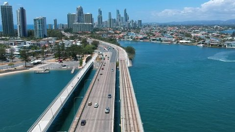 A bridge leading into a city over a large body of water