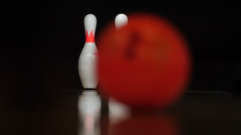 Bowling Playing Competition and recreation. In pin bowling, the goal is to knock over pins at the end of a lane, with either two or three balls per frame allowed to knock down all pins.