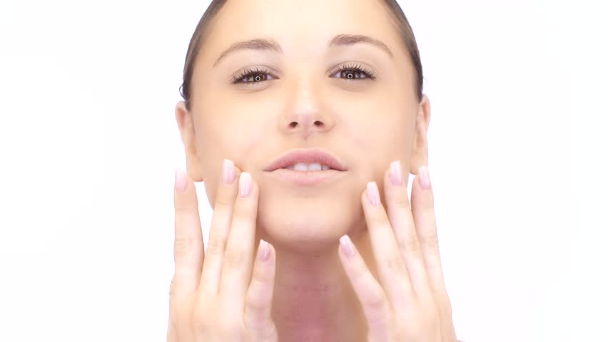 Skincare beauty facial theme. Beautiful young woman applying cosmetics products for anti aging. Skin care is a routine daily procedure in many settings, such as skin that is either too dry. | Shutterstock HD Video #1026870494