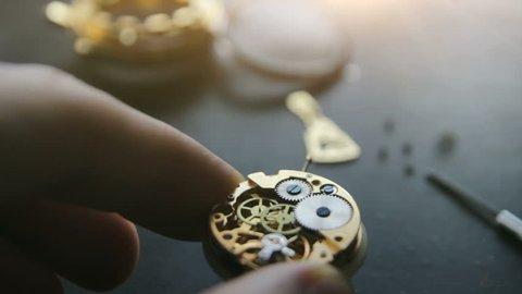 Watchmaker is repairing the wristwatch, mechanical watch, sunlight