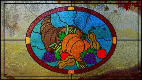 Stained Glass Thanksgiving Sunny Fall Day 4K Loop features a stained-glass window with a picture of a horn of plenty depicted with a fall scene through the window with leaves falling