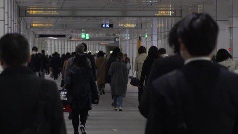 SHINJUKU,  TOKYO,  JAPAN - CIRCA APRIL 2019 : Scenery of RUSH HOUR at SHINJUKU.  Back shot of unidentified crowd of people going back to home from work.