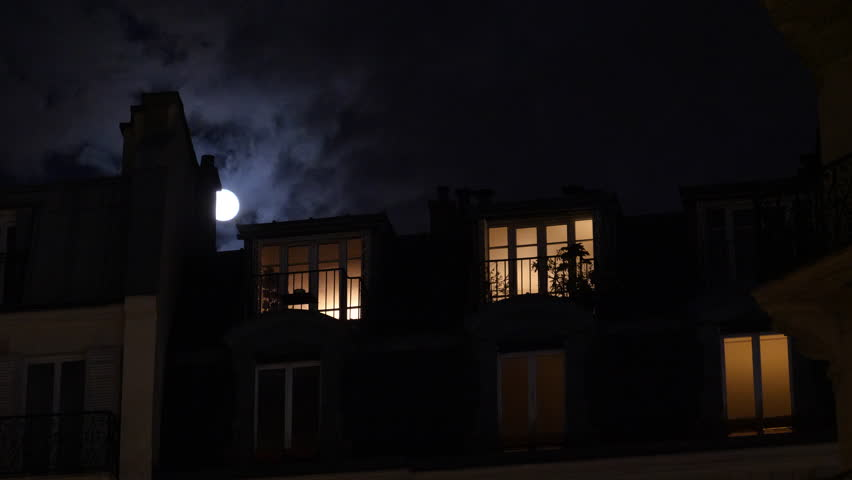 Beautiful full moon over Parisian Hausmannian building on Champs-Elysees at night with beautiful mansard roof illuminated balconies logia windows 4K UHD footage for film and series | Shutterstock HD Video #1026939464