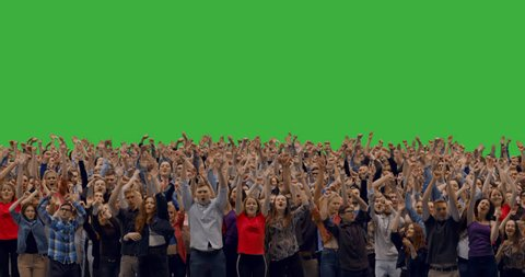 GREEN SCREEN CHROMA KEY Model released, front view of huge crowd jumping and cheering at a concert or a show. 4K UHD ProRes 4444