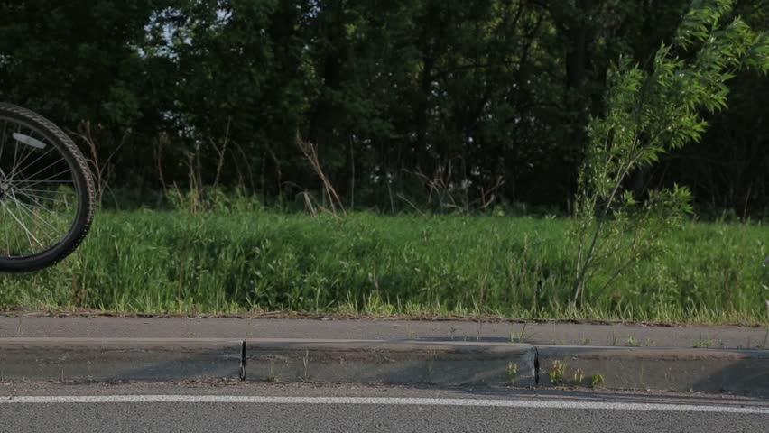 The bike wheel rolls down the road | Shutterstock HD Video #1027090844