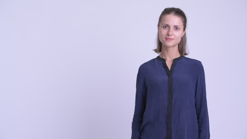Happy young beautiful businesswoman touching something and crossing arms | Shutterstock HD Video #1027112144