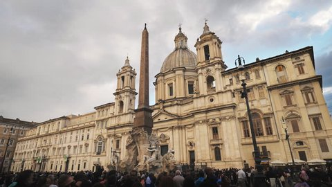 ROME, ITALY - OCTOBER 06, 2018: Tourists crowd in Piazza Navona, a Baroque architecture square from the 1st century A.D., with the Fountain of the Four Rivers and the Egyptian Obelisk in the middle