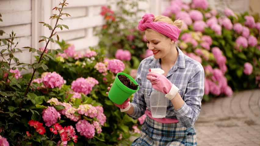 Shutterstock & Girl Plants a Flowers in Stock Footage Video (100% Royalty-free) 1027179254 | Shutterstock