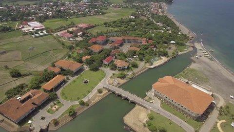 Dolly Out Aerial Footage of Old Houses in Las Casas Filipinas De Acuzar