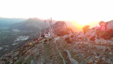 Aerial drone view of telecommunication antennas at sunset, in Segaria mountain, in Marina Alta, Alicante, Spain