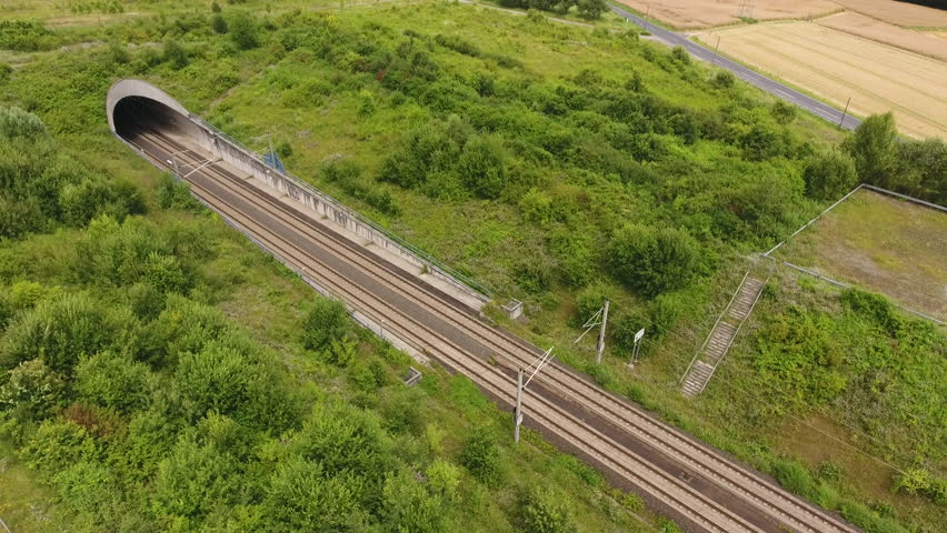 Tunnel entrance of high speed train track - aerial view, drone footage   Shutterstock HD Video #1027220774