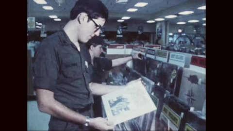 CIRCA 1977 - People shop for various items at an army Post Exchange.