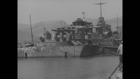 CIRCA 1944 - Wrecked port facilities in Toulon are shown.