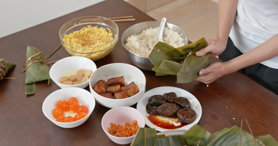 Woman make rice dumpling at home #1027286414