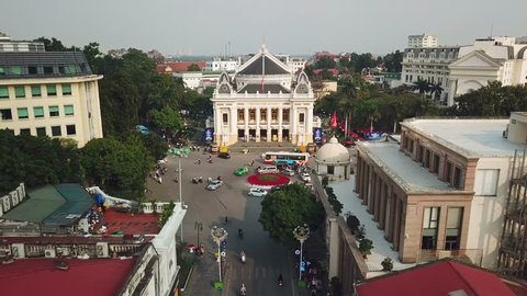 Unique descent close to facade opera house central Hanoi Vietnam French colonial. Circular interchange road traffic Transport bikes. City life Important sights. Culture history. Aerial