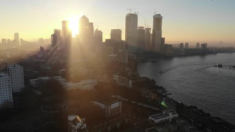 Aerial view of Canary Wharf, London's financial district at sunrise as the sun was passing behind the tall buildings