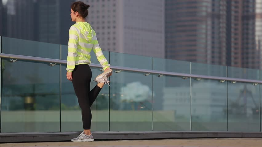 Sporty asian woman doing workout in the city | Shutterstock HD Video #1027435634