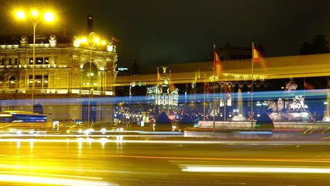 Cibeles fountain in Madrid. Night traffic in Madrid, Spain. Time lapse. Fountain is built in 1782.