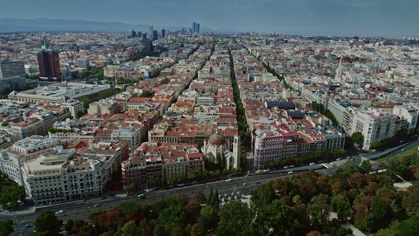 Aerial Drone Over Town Madrid Parque del Retiro Calle de Alcalá Torre Cepsa San Manuel y San Benito Church Spain 4k | Shutterstock HD Video #1027452044
