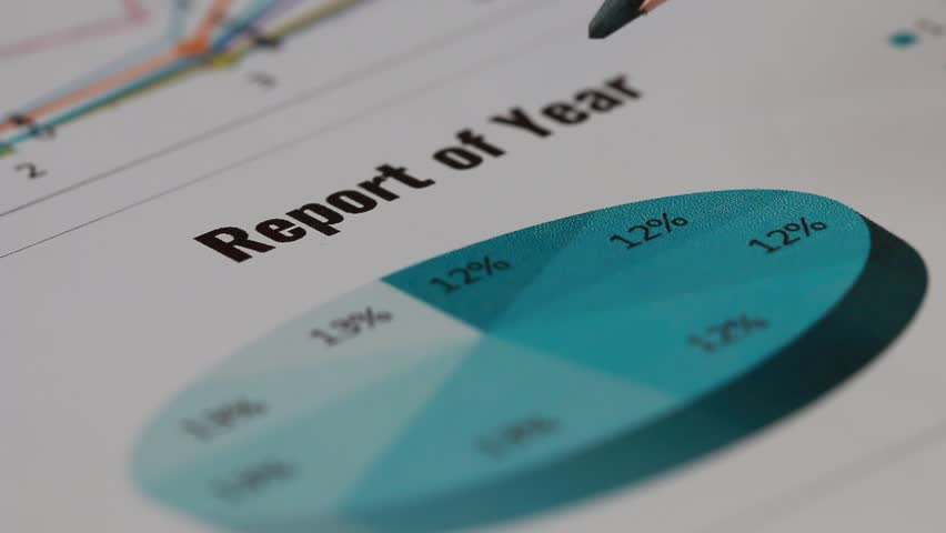 Report of year. Businessman checking document charts graphs show report results for successful of work business and analyzing financial diagram statistics reports or marketing research planning.