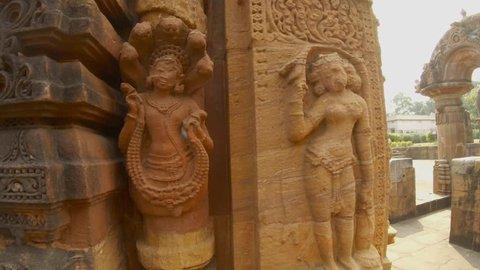 hindu deities apsara and naga bas-reliefs on wall of ancient hindu temple Rajarani Bhubaneswar Orissa