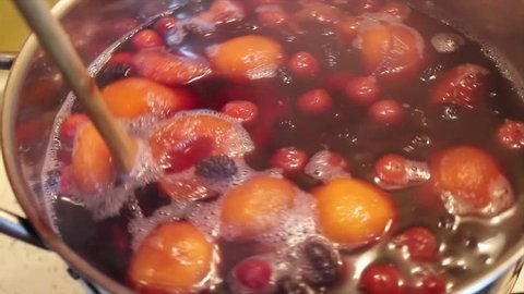 Cooking stewed fruit.  Stir the boiling compote. Cooking at home.