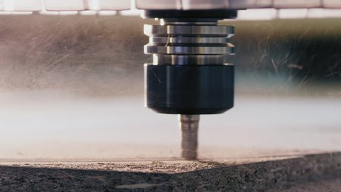 Milling machine with CNC cutting the wooden workpiece. Closeup milling cutter in work