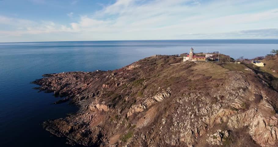Drone footage: Lighthouse and coast landscape - Kullaberg, Sweden | Shutterstock HD Video #1027701464