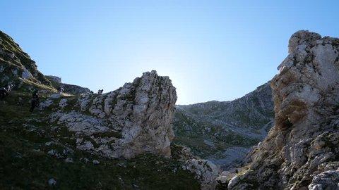 limestone rocks and hikers in backlight, Matese mountains, Roccamandolfi, Campania and Molise, Italy