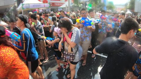 Bangkok, Thailand-April 14, 2019: Locals and tourists celebrate Songkran Festival, Traditional Thai New Year. People play water, and use water guns to enjoy the festival.