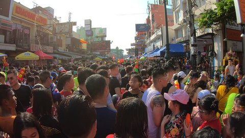 Bangkok, Thailand-April 13, 2019: Locals and tourists celebrate Songkran Festival, Traditional Thai New Year. People play water, and use water guns to enjoy the festival.