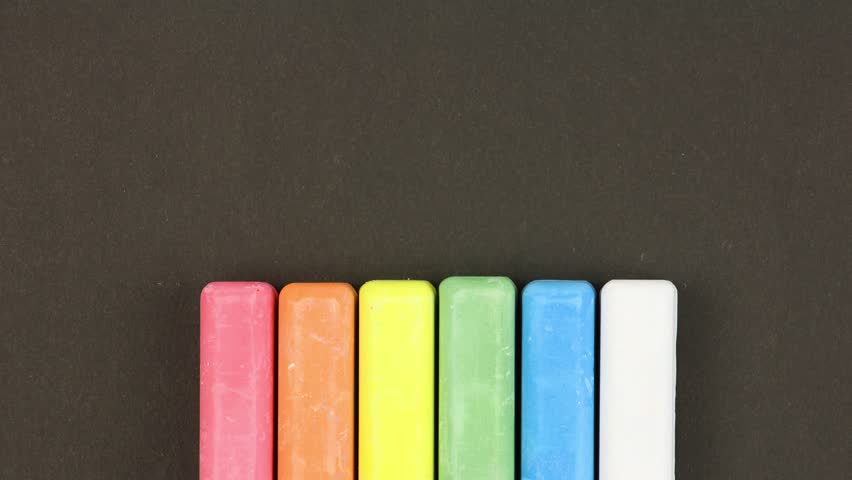 Six colored children crayons on black background lined in a row, first crayons come out sequentially then randomly, closeup, loop video, stopmotion animation, kindergarten education concept   Shutterstock HD Video #1027840034