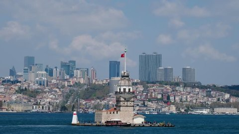 ISTANBUL, TURKEY, APRIL 18, 2019: Passing in front of Maiden's Tower, since the medieval Byzantine period, is a tower lying on a small islet located at the southern entrance of the Bosphorus.