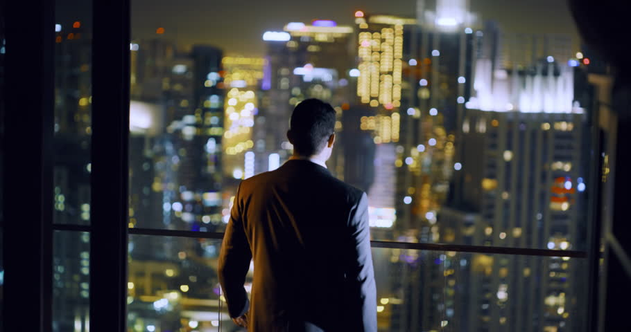 Successful Young Man Standing At Balcony City Skyline Dubai Urban Panorama Fame Night City Lights Slow Motion Red Epic 8k | Shutterstock HD Video #1027882874