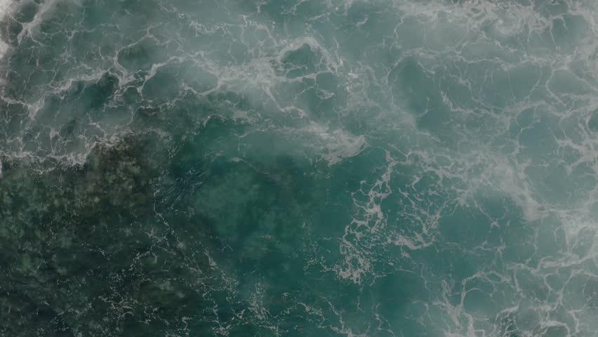 Aerial view of crushing ocean waves. Drone shot of waves. #1027889324