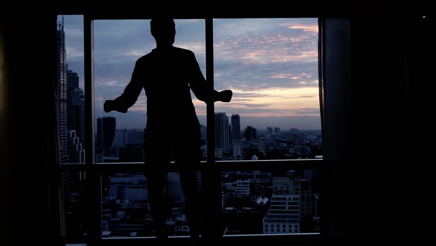 Happy man dancing close to the window, super slow motion   | Shutterstock HD Video #1027889774
