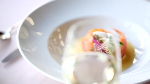 dishes in the restaurant.  bubbles of champagne. egg poached with salmon. Fish with baked vegetables. Luxury. Dinner. White. Healthy food. Delicious. Basil. Lunch. Alcohol.