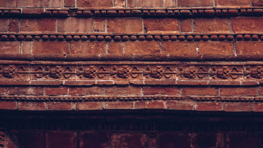 Footage of ancient Italian building made of red bricks.Close up video of very old christian cathedral in Italy.Classic architecture, church exterior design | Shutterstock HD Video #1027921874