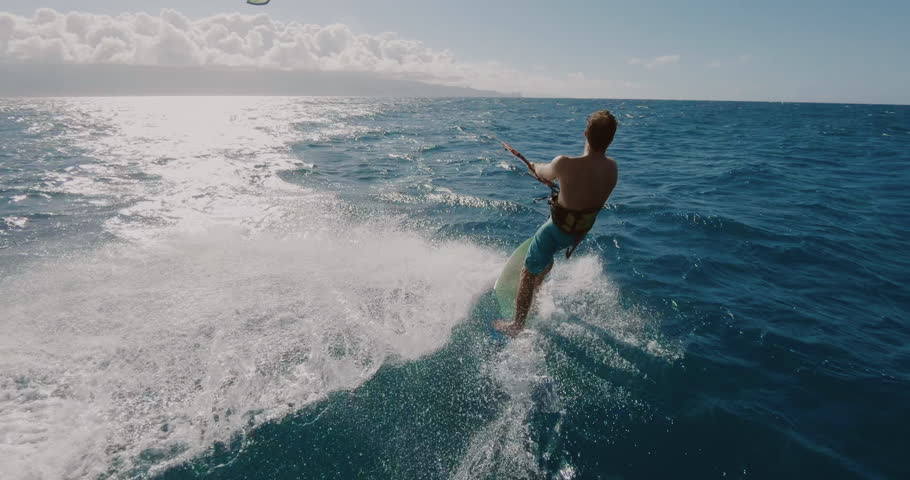 Young athletic man kitesurfing POV follow cam in slow motion, extreme action sports POV, tropical island surf adventure | Shutterstock HD Video #1027946264