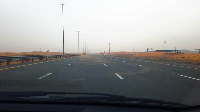 Dubai, United Arab Emirates - April 17, 2019: Highway scenery through the UAE desert during a sandstorm after rain | Shutterstock HD Video #1027984544