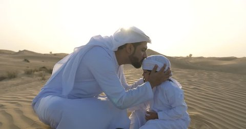 Happy father and son spending time in the desert playing and doing activities