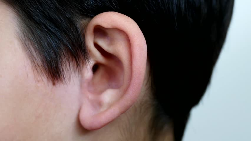 Aching human ear, ear massage, ear infection, close-up human ear, | Shutterstock HD Video #1028008244