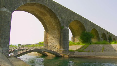 Tsar's Bridge (Serbian: Carev Most) in Niksic, Montenegro. Old ancient stone bridge from the 19th century. Carev Most in Niksic. Emperor's Bridge