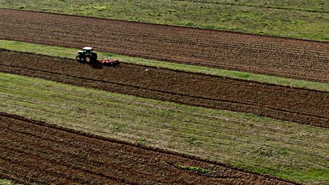 Tractor cultivating arable land, December 2108: Tractor cultivating arable land in the Algarve countryside, south of Portugal