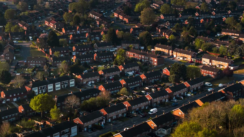 Aerial Shot of classic British housing estate, English houses and homes from above    Shutterstock HD Video #1028043434