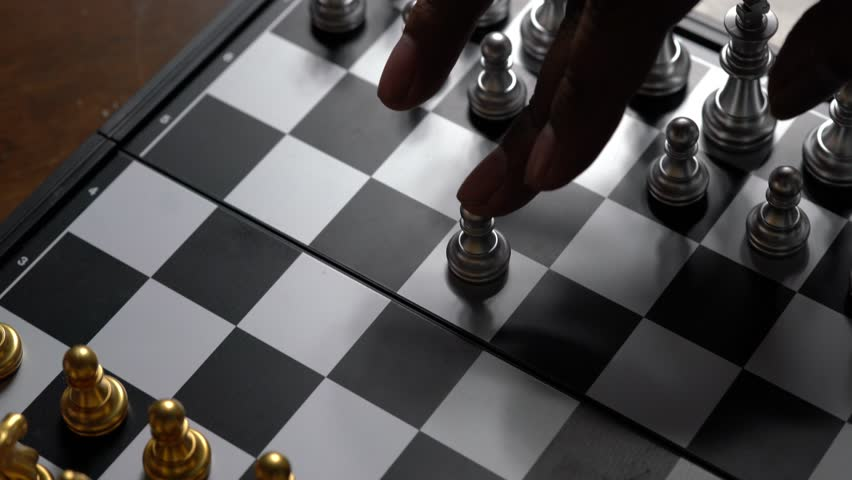 Hand moving chess pawn defeat enemy on chessboard winner and victory concept,strategy planning business | Shutterstock HD Video #1028142734