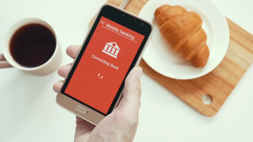 Some trouble with mobile banking in the smartphone. Online bank cannot connect. Smartphone in the hand. Breakfast. Red custom interface design. | Shutterstock HD Video #1028174954