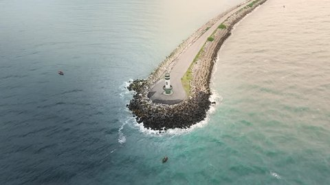 Aerial view circling a lighthouse of Farol Do Molhe Da Barra De Itajaí, Santa Catarina, Brazil.