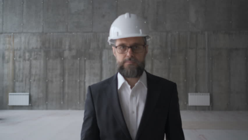 Professional people at work, portrait of architect with safety helmet in construction site, looking at camera #1028237894