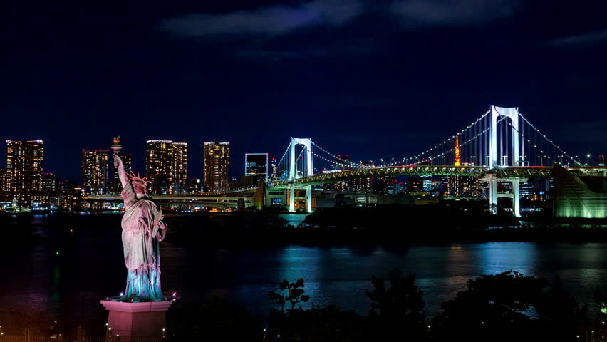 Night Time lapse of Rainbow bridge in Odaiba, Japan with Statue of Liberty in foreground | Shutterstock HD Video #1028247104